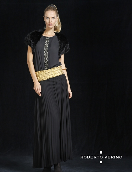 Long pleated skirt and black top with bolero