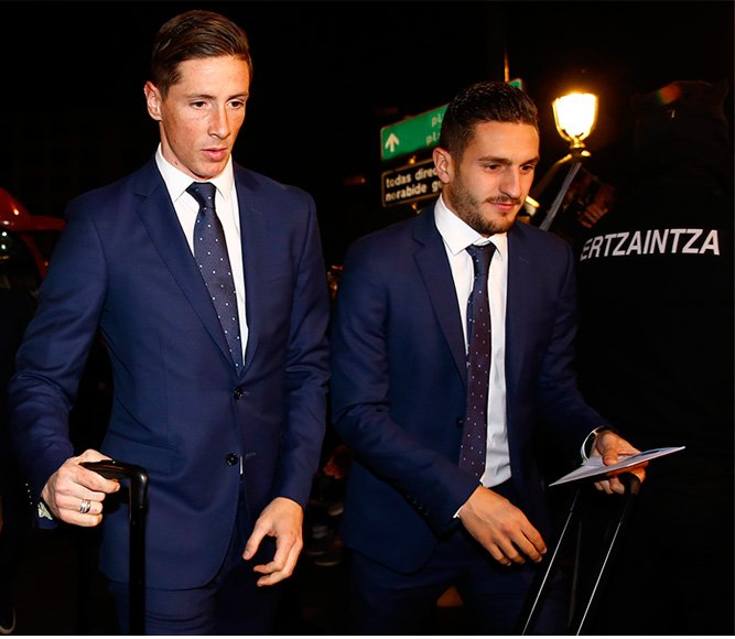 Fernando Torres and Koke wearing a Roberto Verino suit