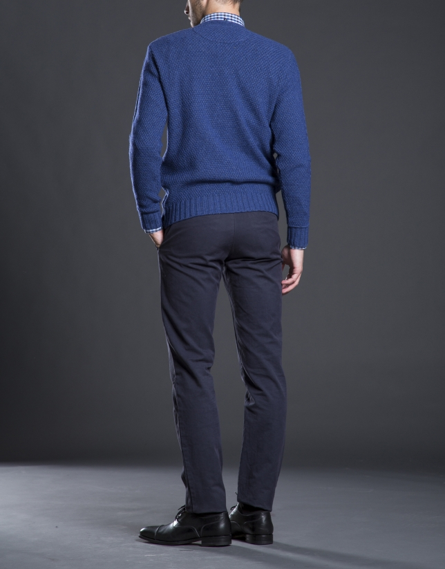Blue V-neck sweater with cable stitch design
