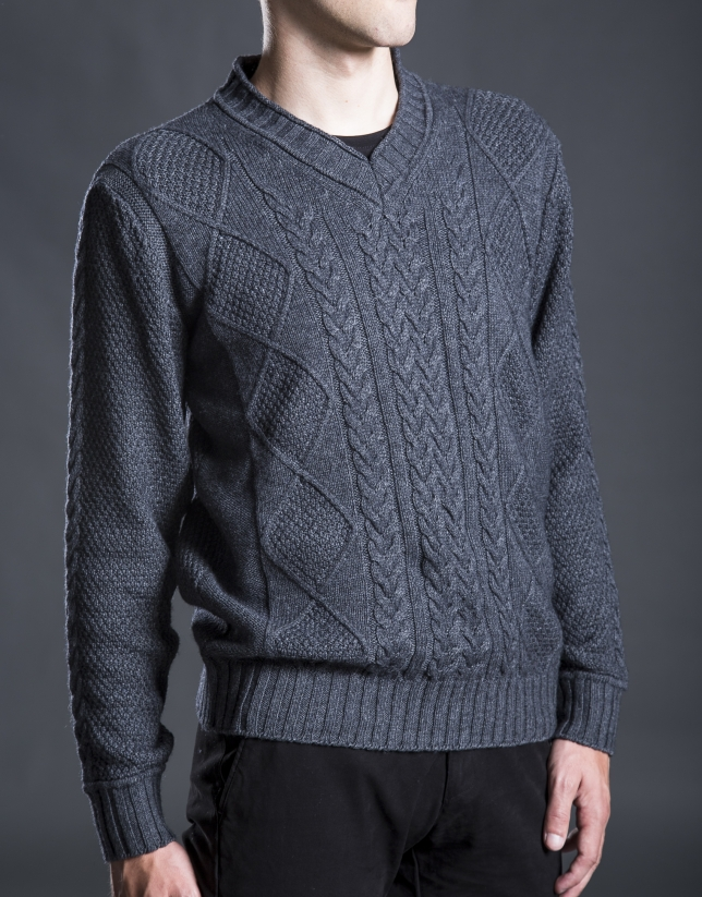 Gray V-neck sweater with cable stitch design