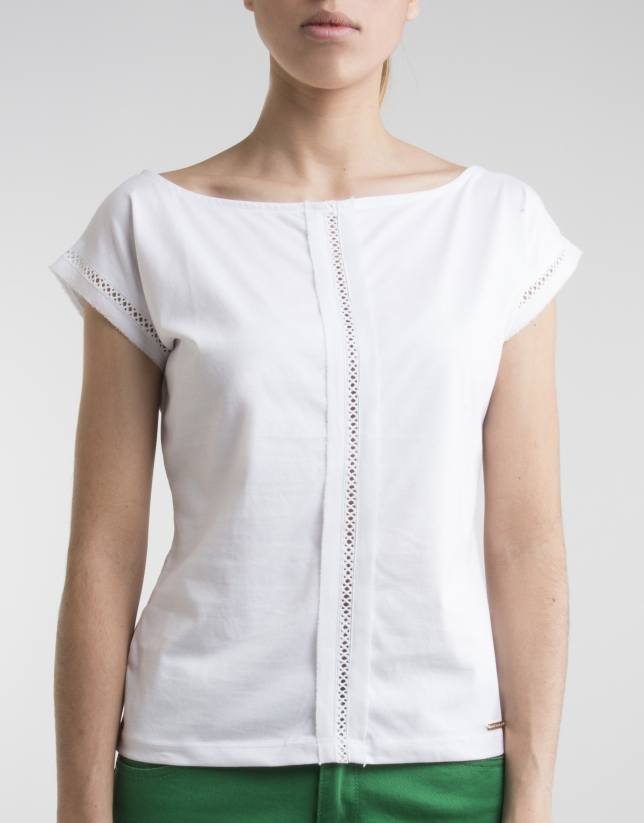 White top with decorative panel