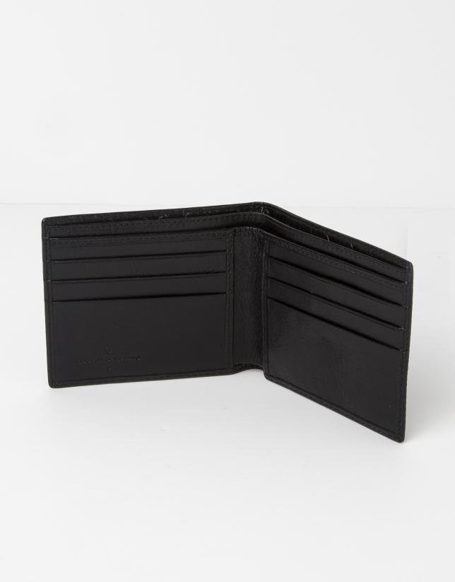 Billetera negra piel grabada RV.