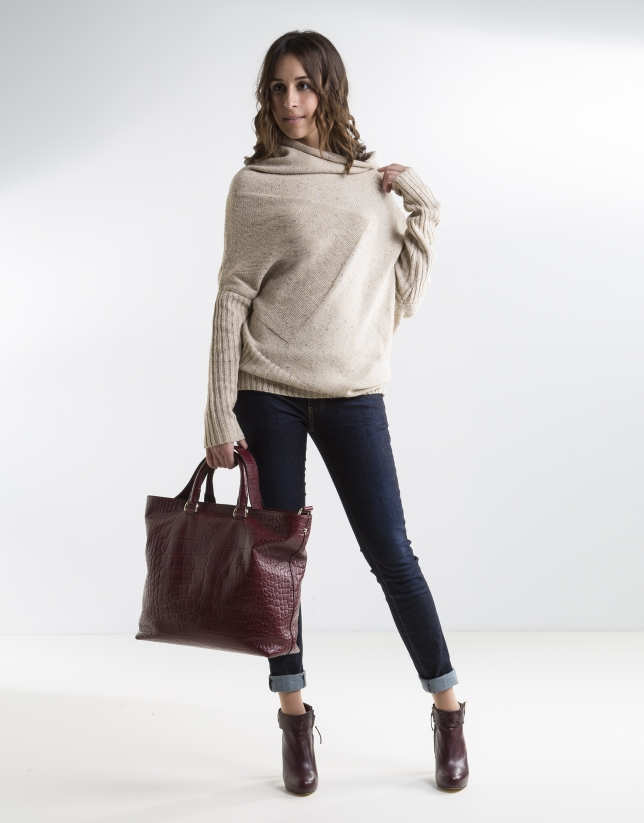 Long beige asymmetric sweater