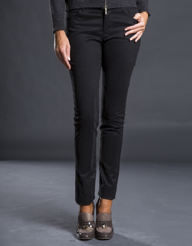 Black pants with inner leg reinforcements