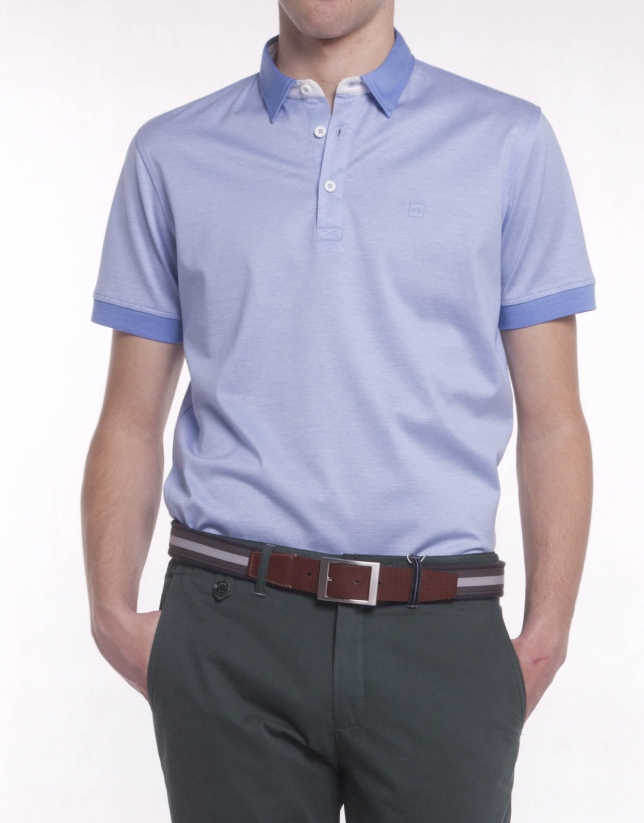 Blue pinstriped polo shirt, contrasting collar and ribbing on cuffs. Contrasting border on collar and interior half moon.