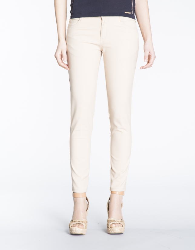 Pantalon stretch écru, 6 poches.