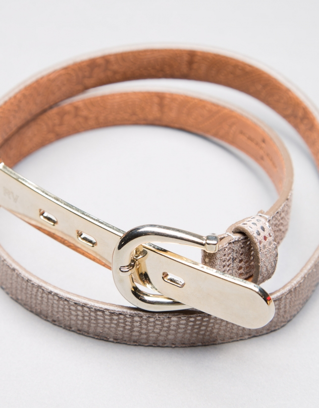 Narrow gilded belt