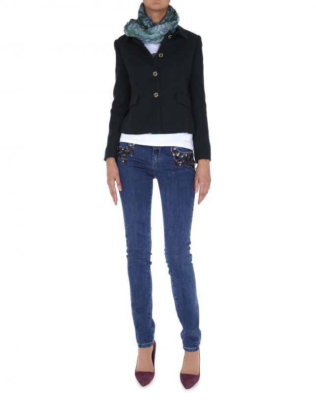 Faded jeans with sequined pockets