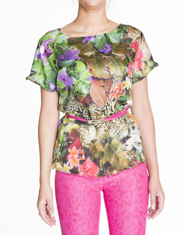 Loose green floral print silk blouse.