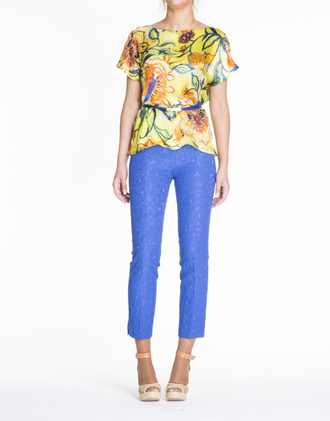 Loose yellow floral print silk blouse.