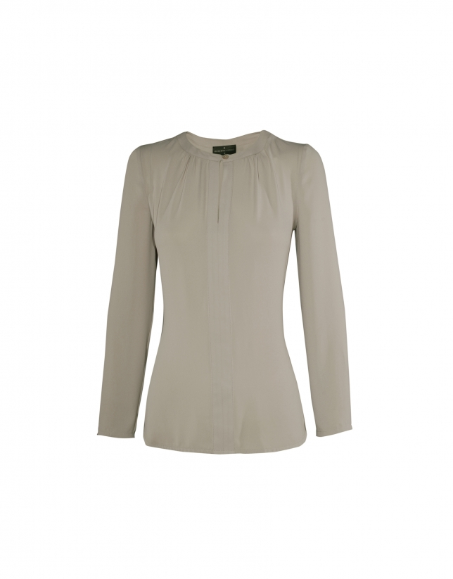 Long sleeved ivory blouse