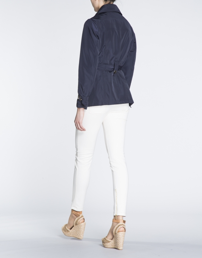 Navy blue gabardine with double row of buttons