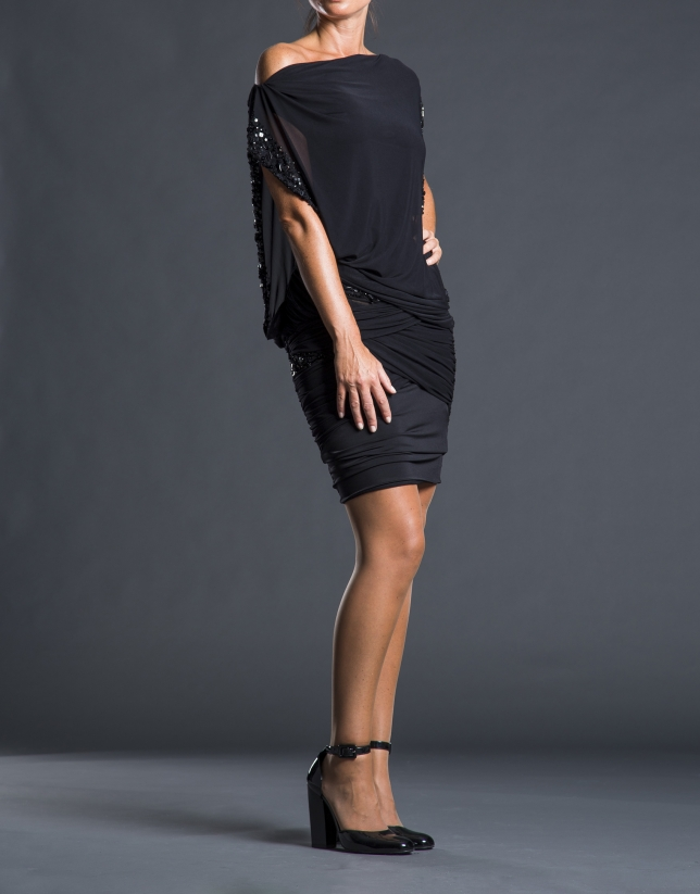 Short black dress with beading