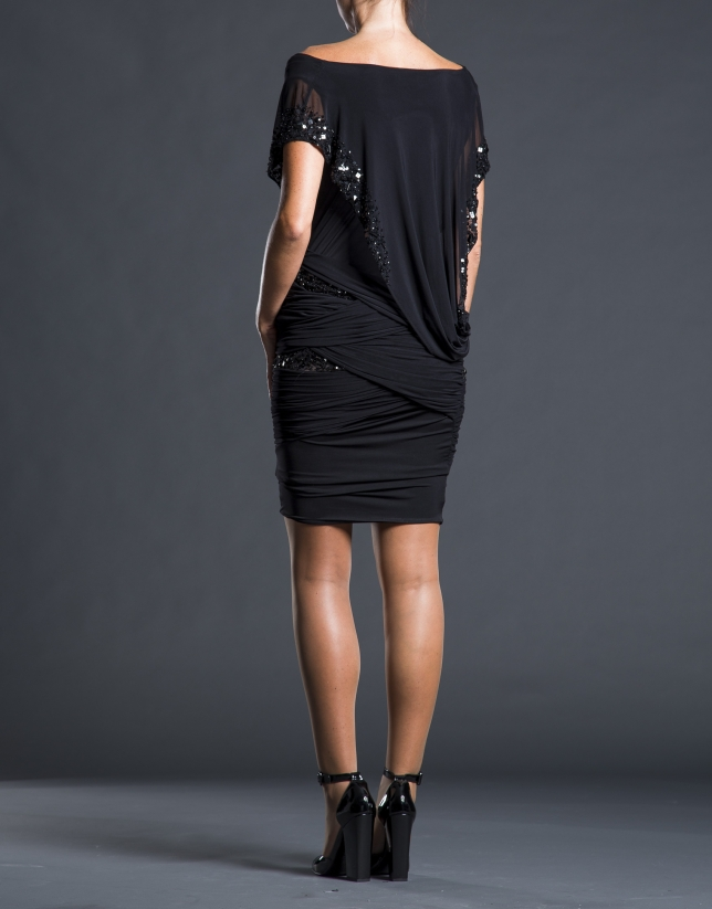 Short black dress with beading