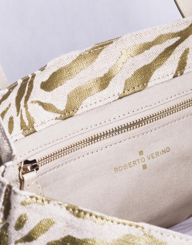 AFRICA: Shopping en tejido con estampado cebra dorado
