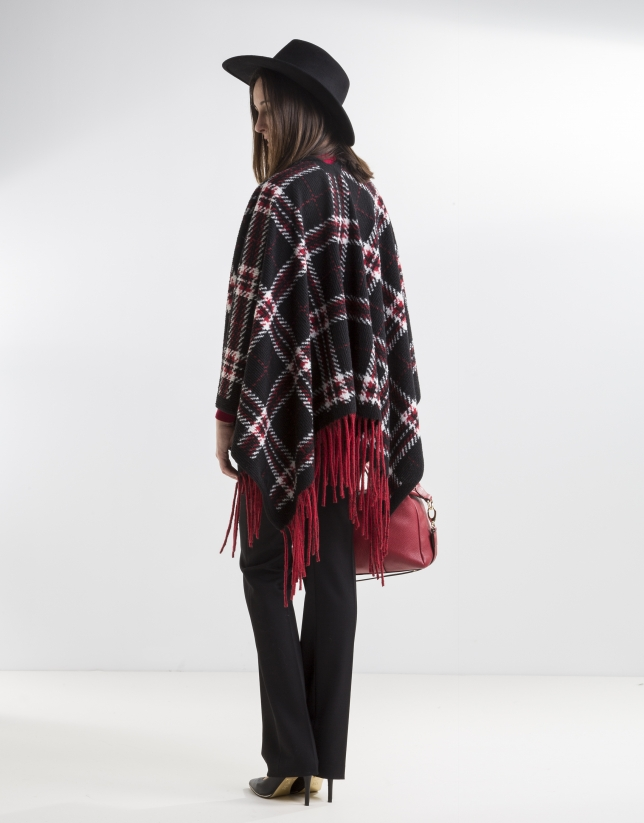 Red fringed poncho