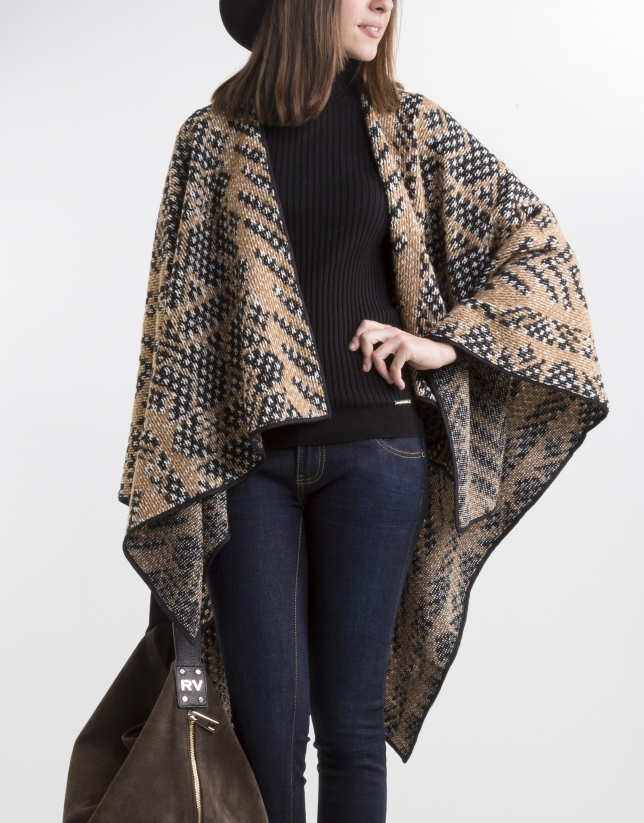 Beige poncho with black trim