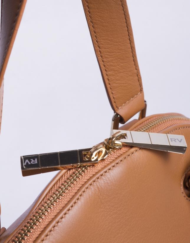 LEONOR CARAMELO:  Napa satchel