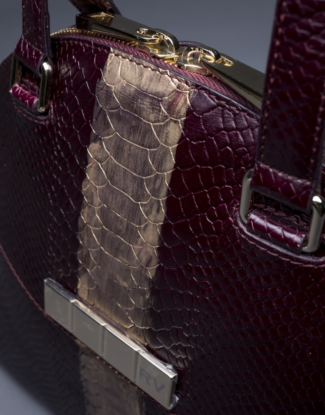 Scarlet leather Leonor Andrómeda bag with embossed snake and old gold stripe