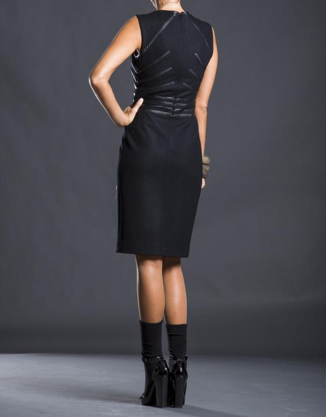 Black dress with fantasy appliqués