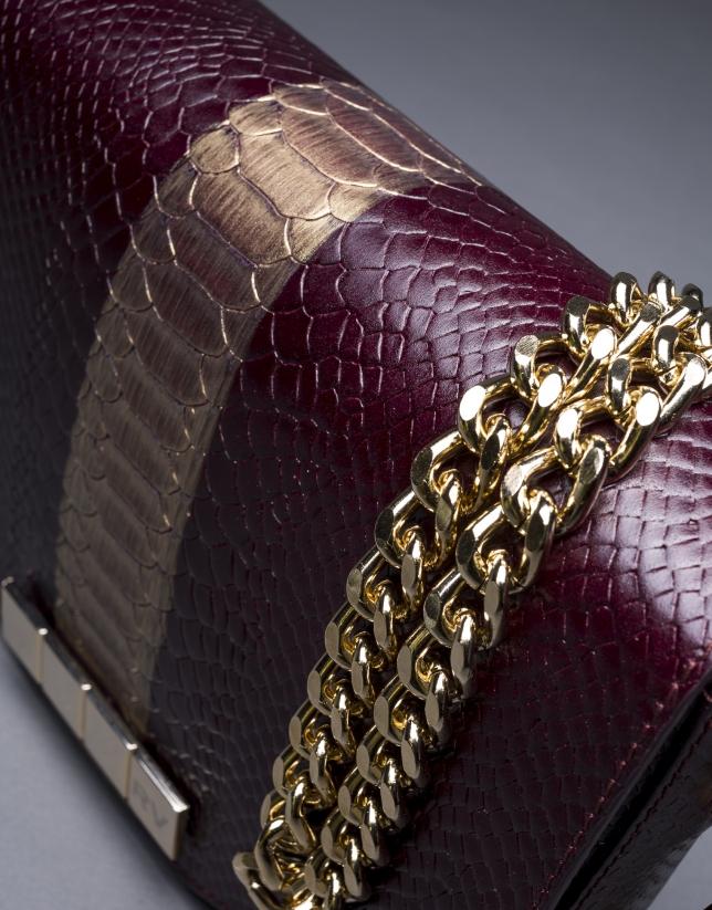 Bolso Alicia Andrómeda en piel burdeos grabado serpiente con franja oro viejo