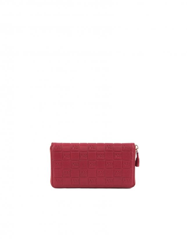 Porte-feuille en cuir vachette rouge.
