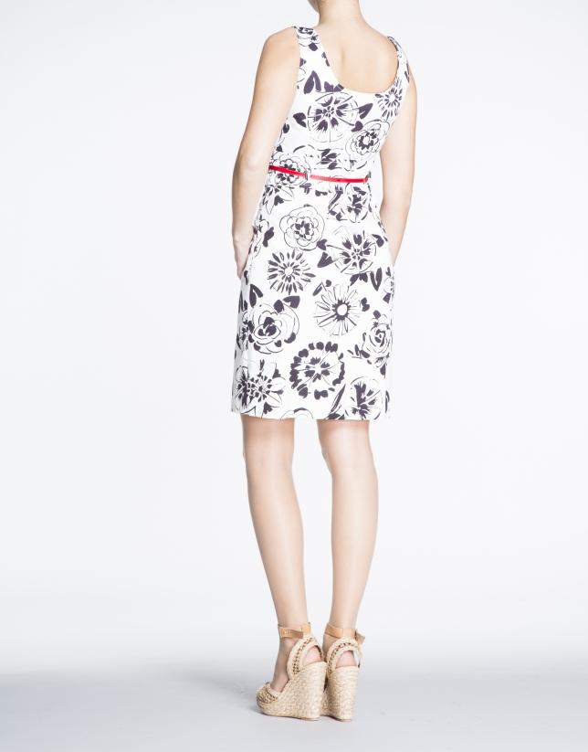 Robe à bretelles, motif floral en noir et blanc.