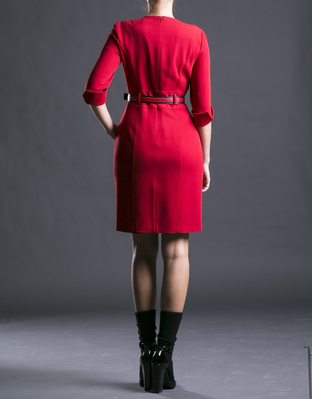 Fitted red dress with belt.