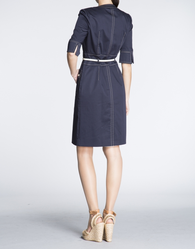 Navy blue three quarter sleeve shirtwaist dress.