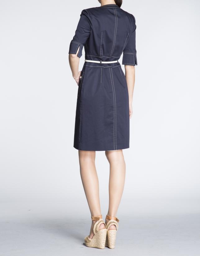 Navy blue three quarter sleeve shirtwaist dress.