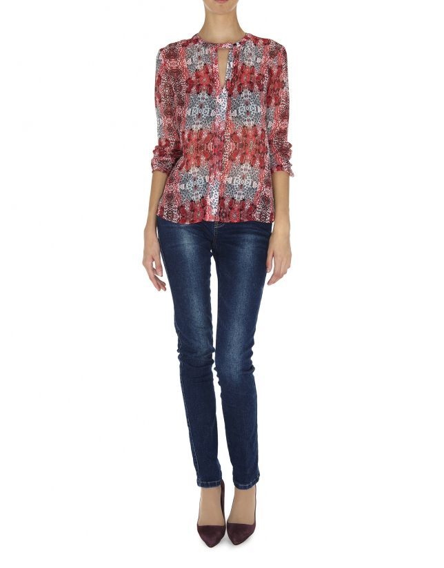 Red print V-neck blouse with tuckered cuffs