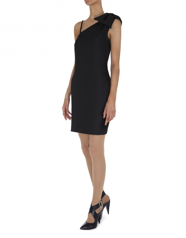 Black asymmetric dress with bow over one shoulder