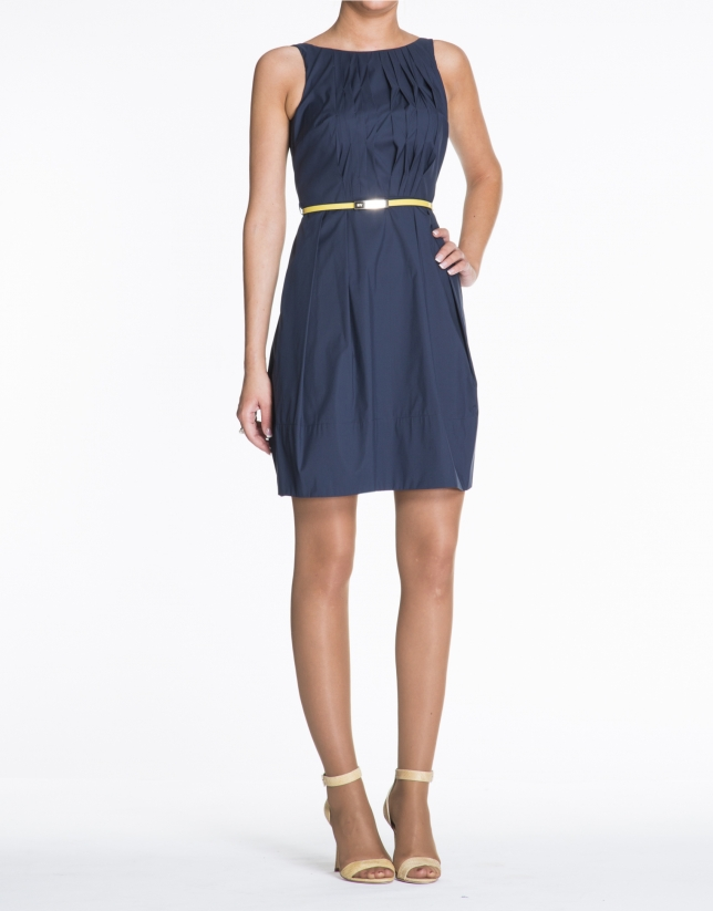 Blue sleeveless cotton dress with tucks.