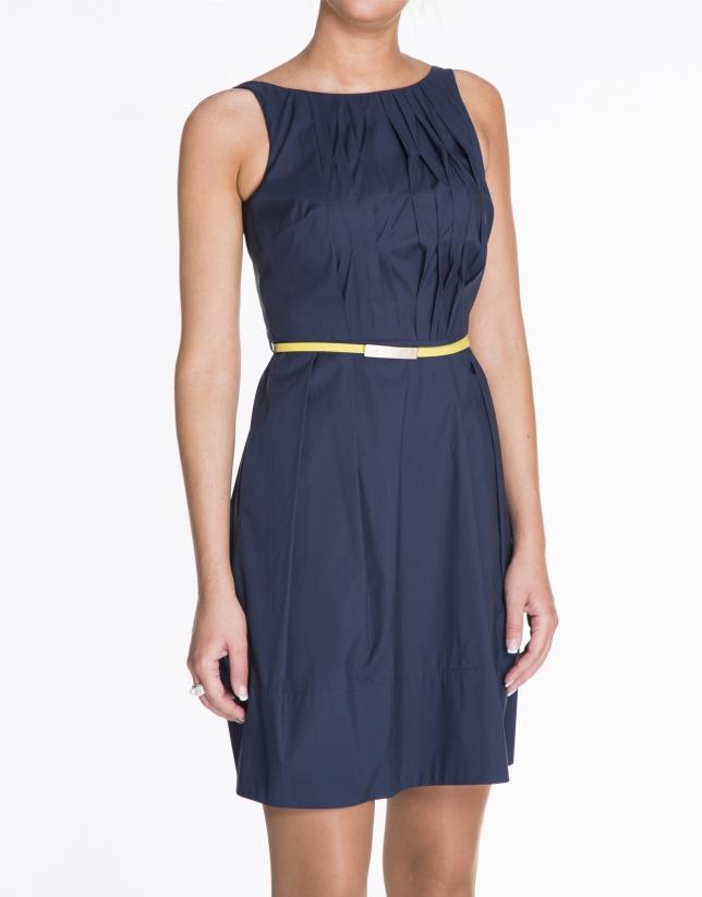 Blue sleeveless cotton dress with tucks.