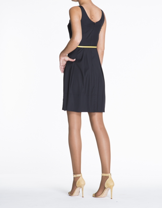 Navy blue sleeveless dress with tucks.