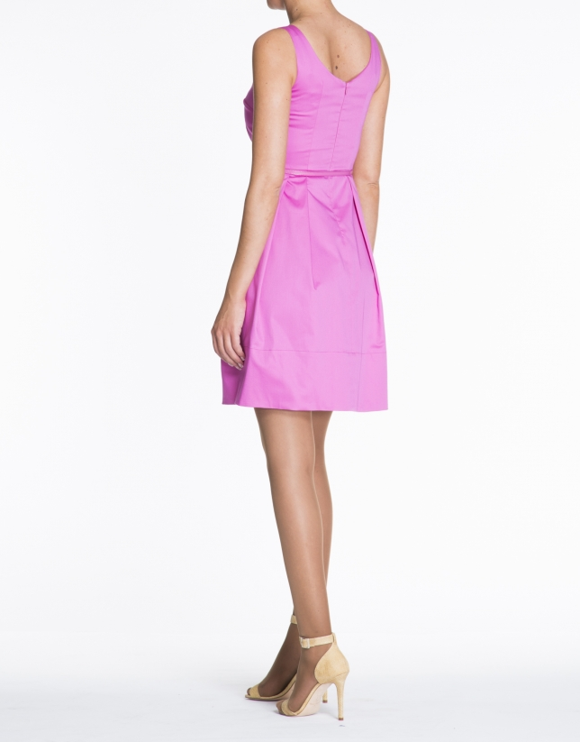 Pink sleeveless cotton dress with tucks.