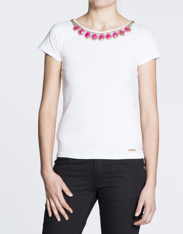 T-shirt blanc en coton avec strass au col.