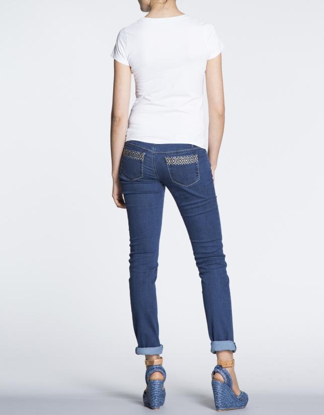 Camiseta de algodón blanca con estampado palmeras.