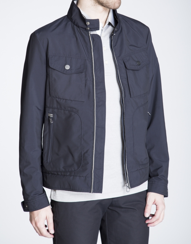 Navy blue track jacket with breast pockets
