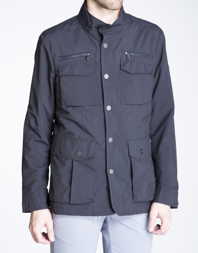 Navy blue track jacket with four pockets