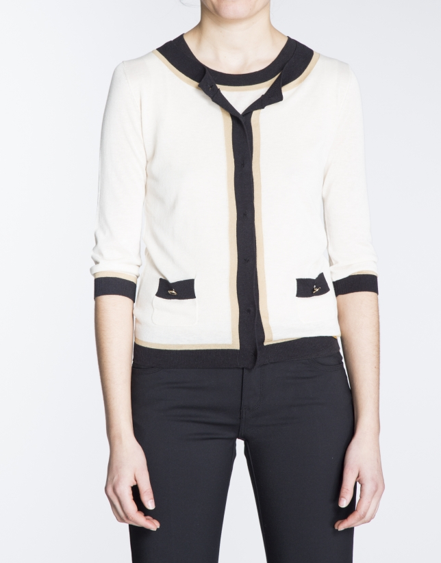 Beige sweater with black and beige trim