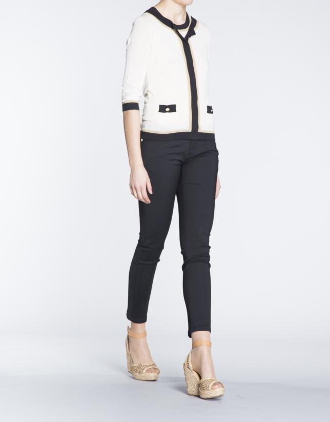Beige sweater with black and beige trim