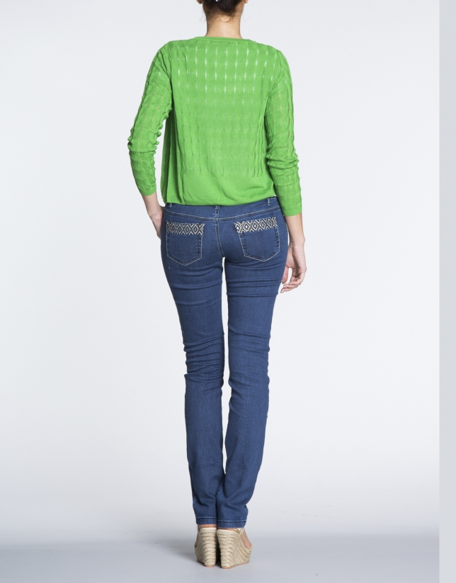 Green sweater with ripple effect