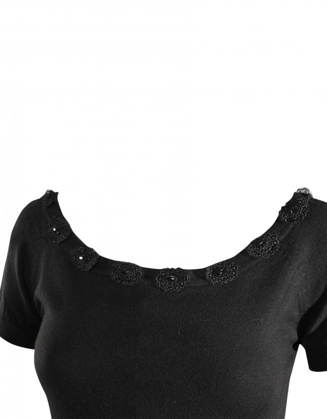 Black knit pullover with embellishments