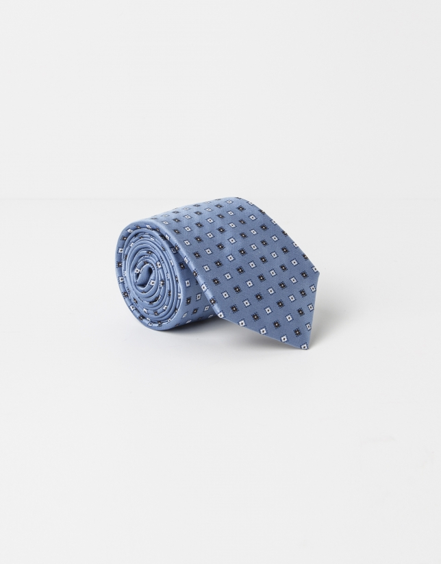 Blue tie with beige dots