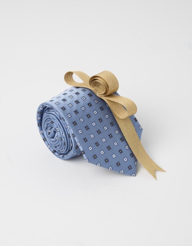 Corbata topos beige fondo azulón