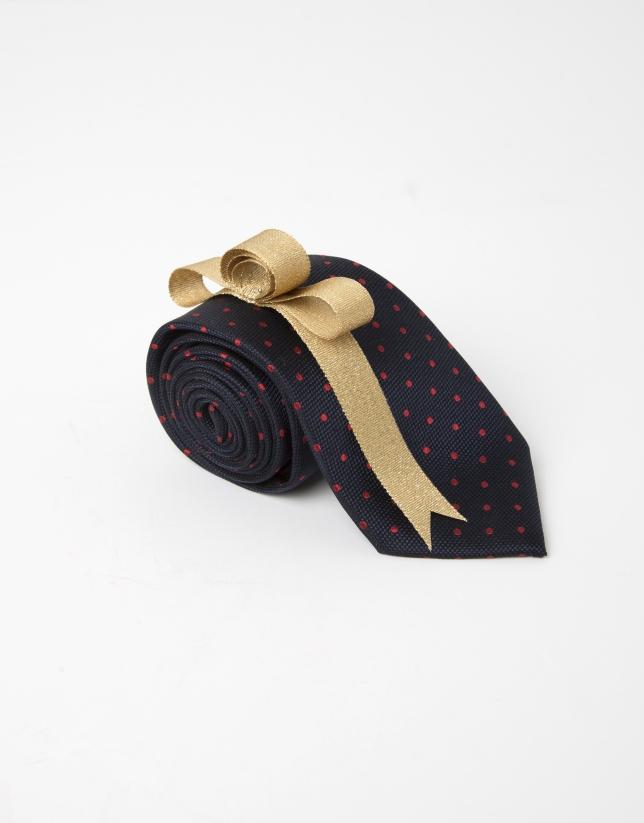 Cravate à pois rouges sur fond bleu marine
