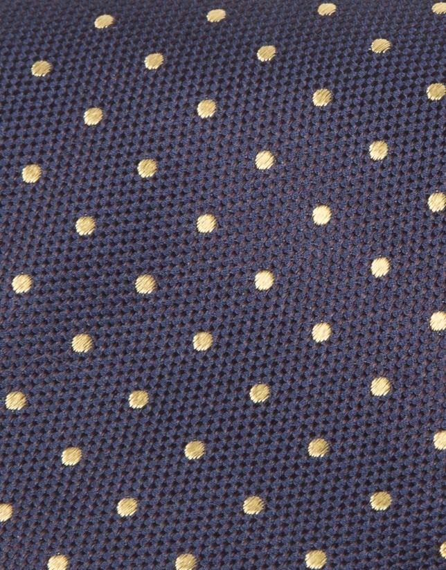 Cravate à pois jaunes sur fond bleu marine