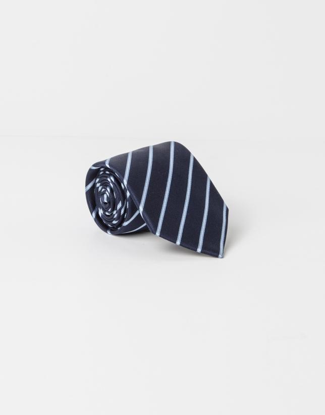 Cravate à rayures célestes sur fond bleu marine