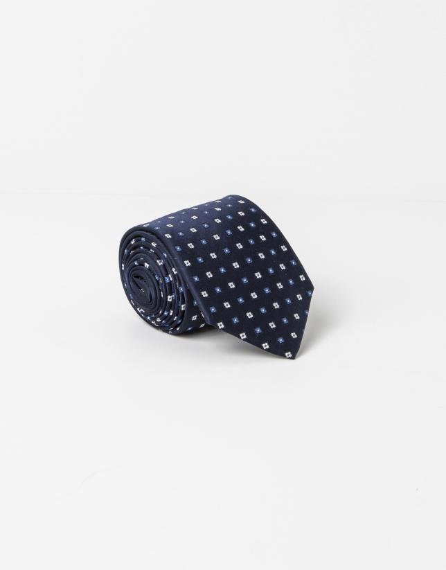Cravate à microdessin gris sur fond bleu marine